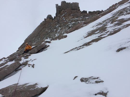 A rescue climber searches Longs Peak in Colorado for Ryan Albert, a missing Marlton man.