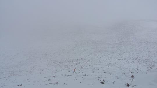 Poor weather conditions have hampered the search for a Marlton man reported missing on Longs Peak in Colorado.