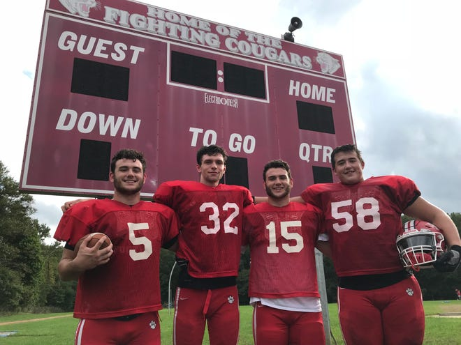 (From left): Cherry Hill East's Nick Gazzola, Zack Frye, Dante Gazzola and Dom Seta were the team's game captains for Saturday's 32-0 victory over Cumberland. It was the Cougars' first win since 2015.
