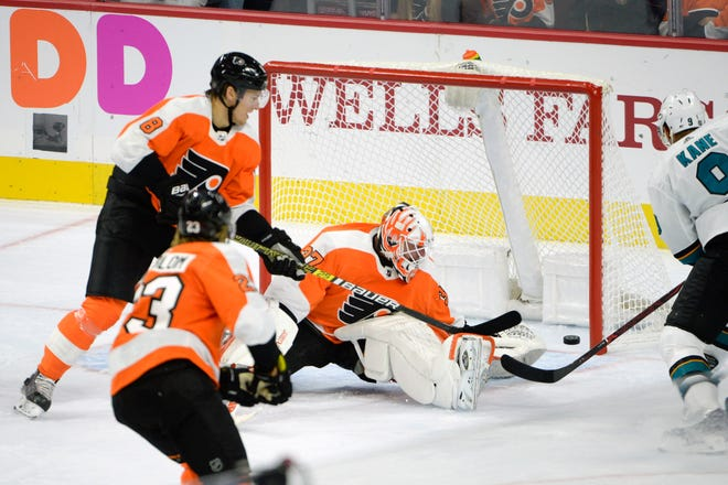 The puck gets past Flyers goalie Brian Elliot (37) during a home opener against the Sharks Tuesday, Oct. 9, 2018 at the Wells Fargo Center in Philadelphia, Pa.