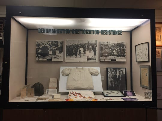 A shirt and pillowcase made from a parachute found by Jews who hid in the Belarussian forest are among the artifacts on display at the Esther Raab Holocaust Museum at the Katz JCC in Cherry Hill.