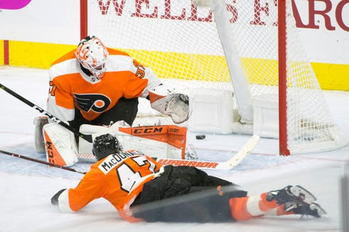 Another puck gets by Flyers goalie Brian Elliot (37) against the Sharks Tuesday, Oct. 9, 2018 at the Wells Fargo Center in Philadelphia, Pa. The Flyers lost 8-2.