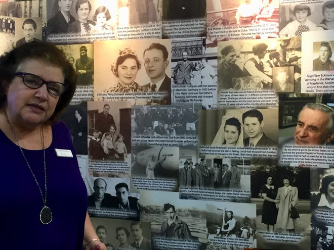 Helen Kirschbaum, director of the Esther Raab Holocaust Museum at the Katz JCC in Cherry Hill, explains photos of Holocaust survivors. The museum will host docent-led tours and offer personal stories as part of Camden County History Week.