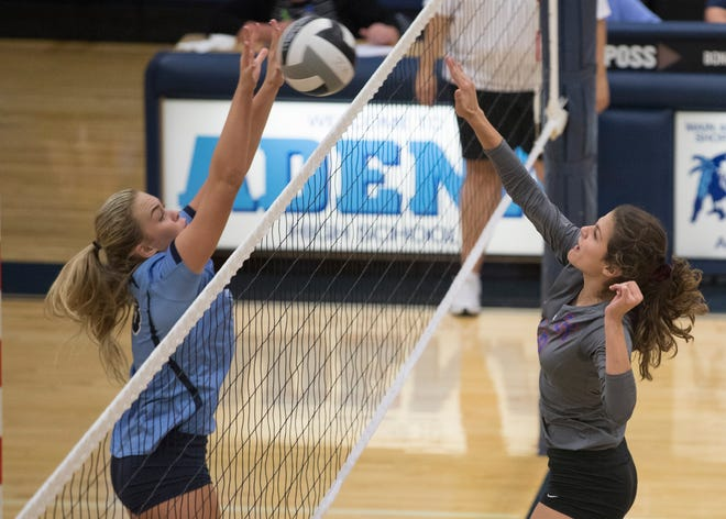 Adena' s Ellie Harper attempts to block a ball spiked by Zane Trace's Emily Allen Tuesday night in Frankfort, Ohio. Zane Trace went on to defeat Adena 3-0 at Adena High School.