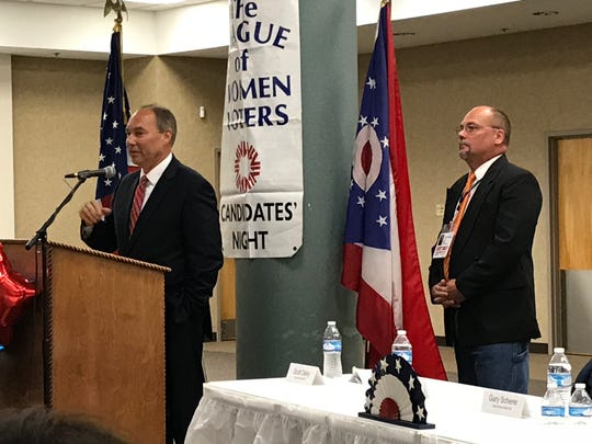 Incumbent 17th District State Sen. Bob Peterson answers a question at Tuesday's League of Women Voters Candidates' Night while his opponent, Scott Dailey, awaits his turn at the podium.