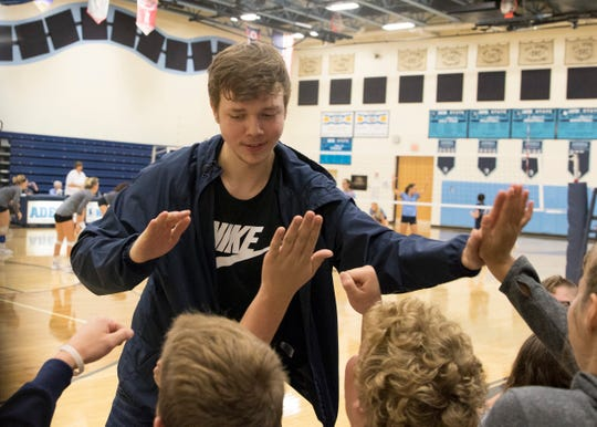 Adena's Isaiah Hooks high-fives fellow students every time Adena scores during their match against Zane Trace Tuesday night in Frankfort, Ohio.