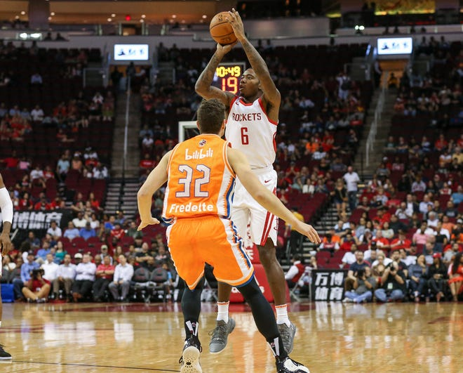 Houston Rockets forward Gary Clark (6) shoots the ball as Shanghai Sharks guard Jimmer Fredette (32) defends during the second quarter at Toyota Center on Oct. 9.