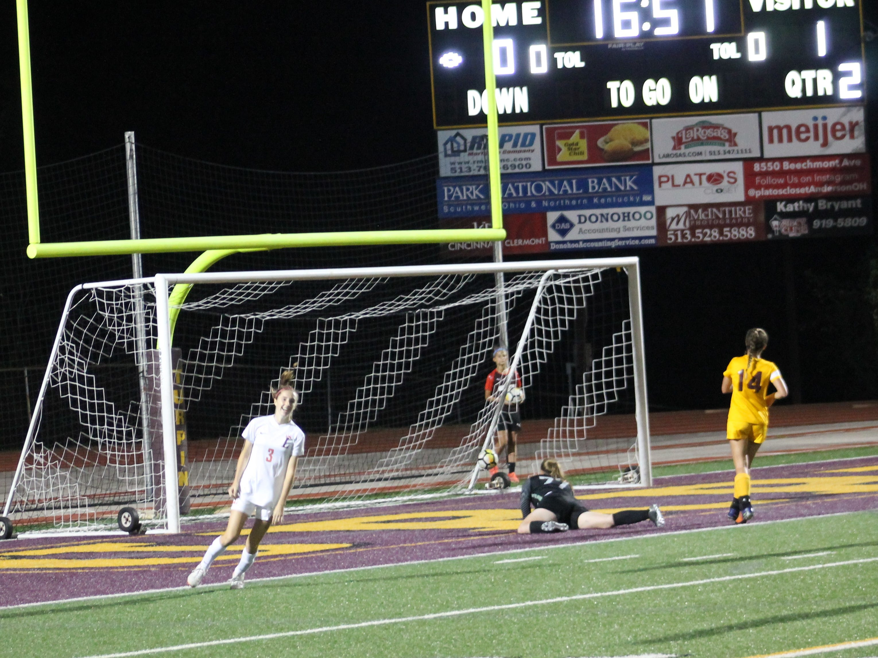 Allison Reynolds puts in the game's second goal for Loveland