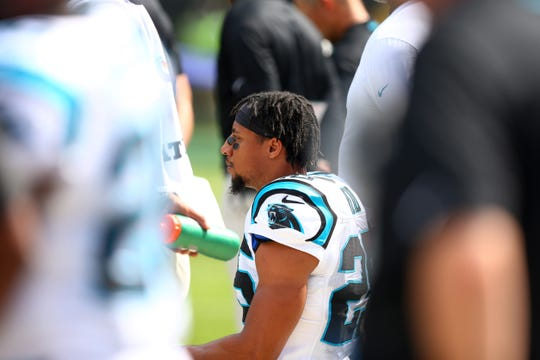 Carolina Panthers defensive back Eric Reid (25) kneels during the National Anthem prior to the game against the New York Giants at Bank of America Stadium.