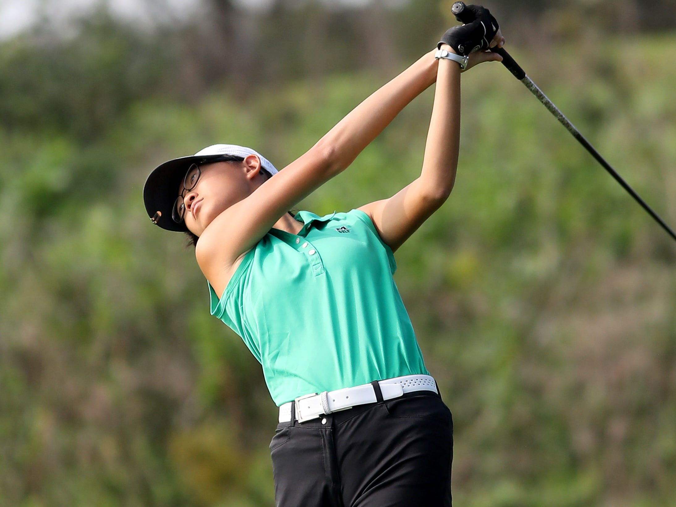 Mason's Julanna Zhang tees off at the district tournament, at GlenView Golf Course, Tuesday, Oct.9, 2018.