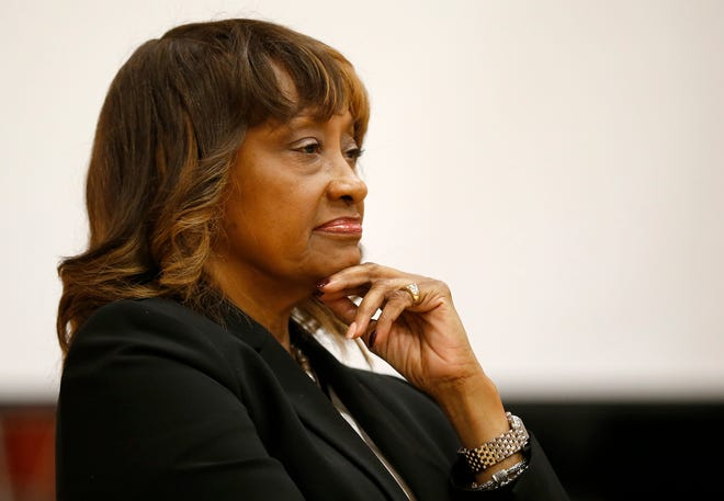 Cincinnati Health Commissioner Melba Moore listens to a panelist during a town hall meeting at South Avondale Elementary School in the Avondale neighborhood of Cincinnati, on Thursday, Oct. 4, 2018.