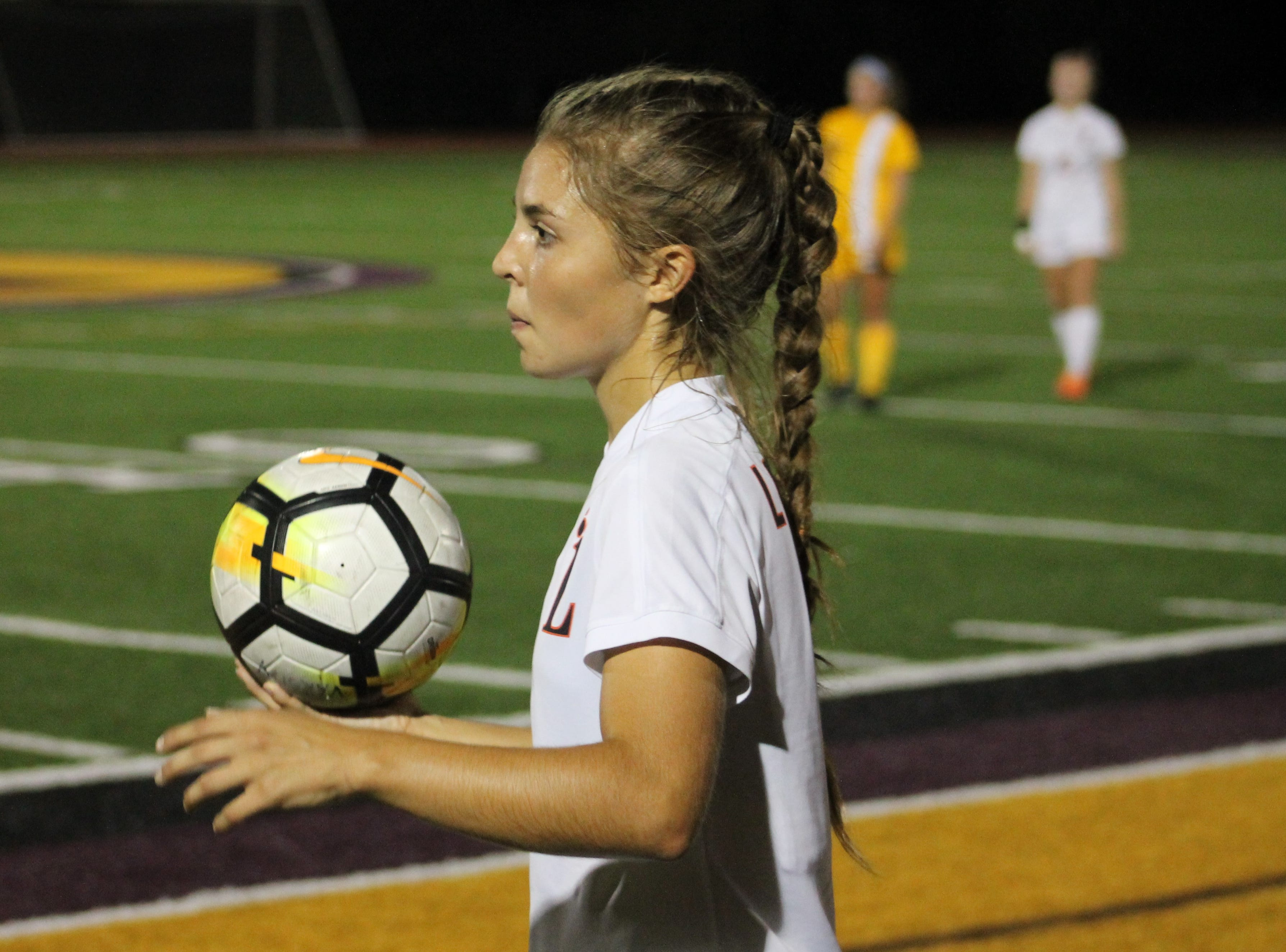 Junior captain Claire Massey throws the ball in for Loveland
