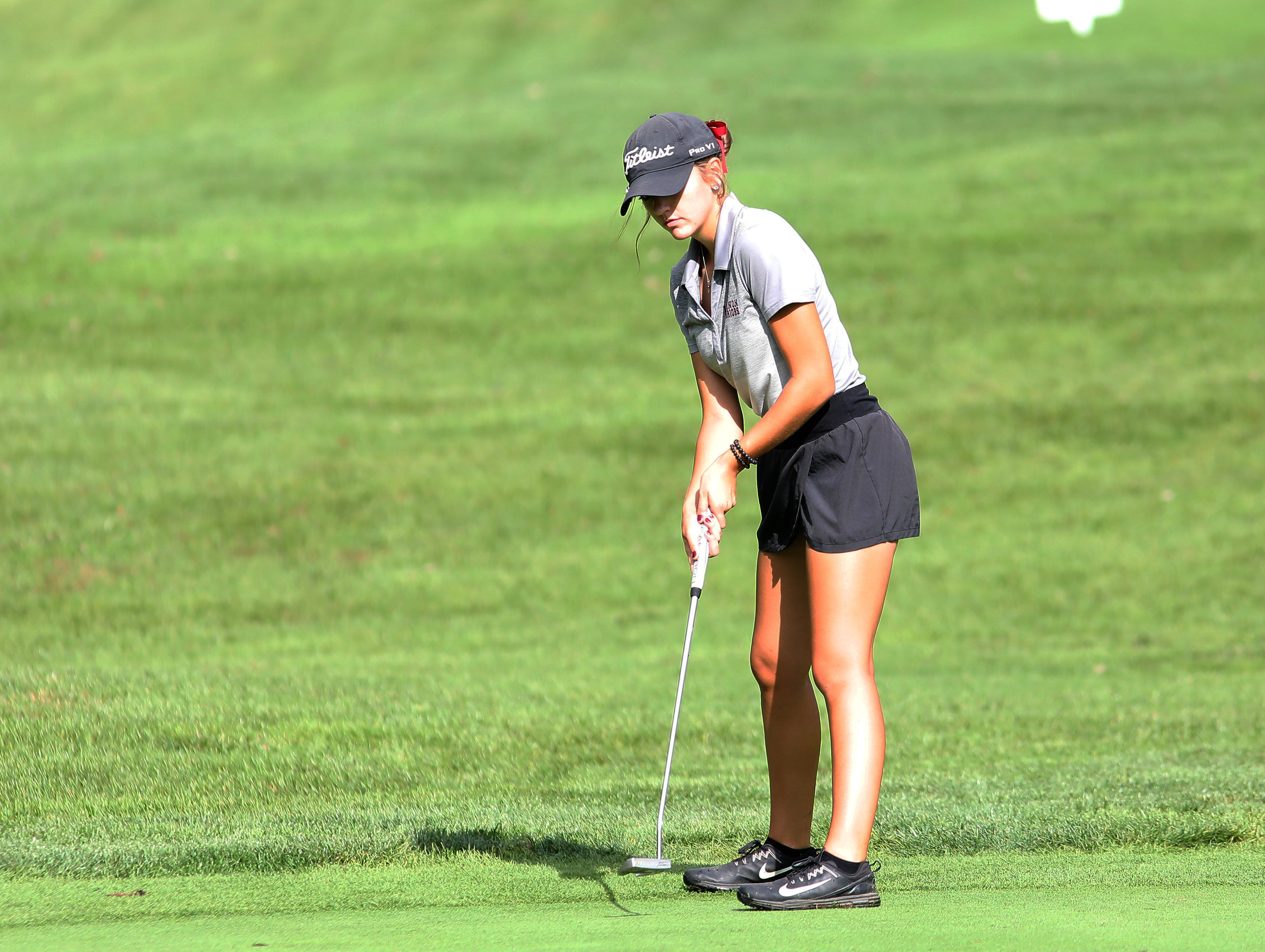Lebanon's Maddie Owens putts during  the district tournament at GlenView Golf Course. Tuesday, Oct.9, 2018.