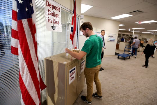 Voters cast their ballots, Wednesday, Oct. 10, 2018, at the Hamilton County Board of Elections in Norwood, Ohio.