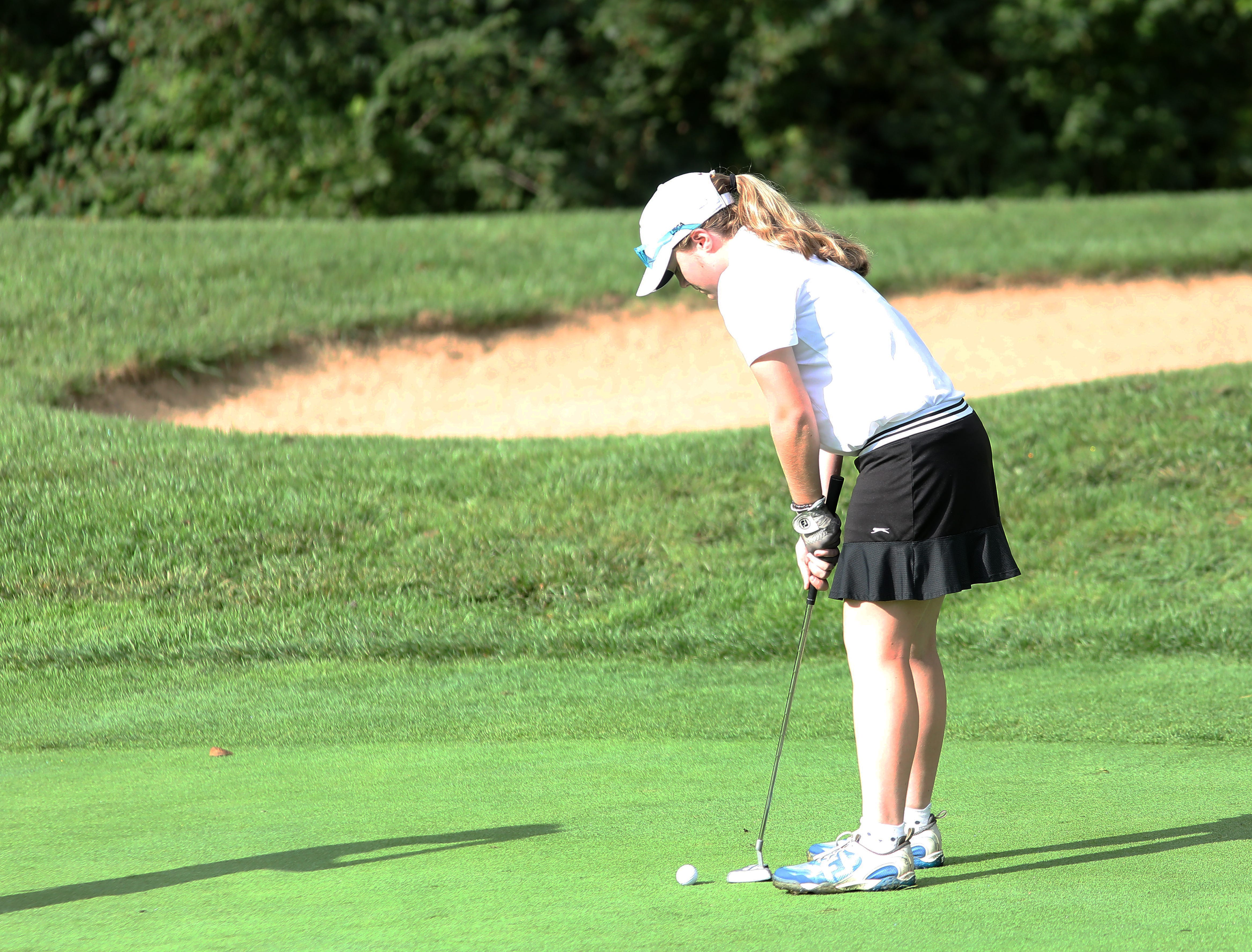 Mt. Notre Dame's Courtney Nichols putts during  the district tournament, Tuesday, Oct.9, 2018.