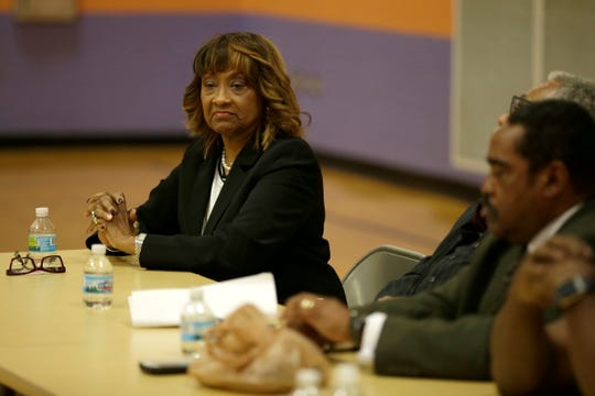 New Cincinnati Health Commissioner Melba Moore takes her seat on a panel during a town hall meeting at South Avondale Elementary School in the Avondale neighborhood of Cincinnati, on Thursday, Oct. 4, 2018.