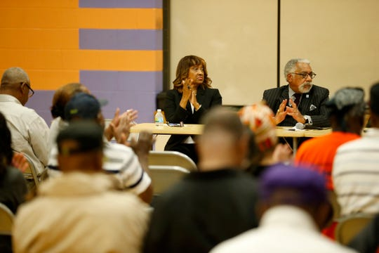 New Cincinnati Health Commissioner Melba Moore listens to a panelist during a town hall meeting at South Avondale Elementary School in the Avondale neighborhood of Cincinnati, on Thursday, Oct. 4, 2018.