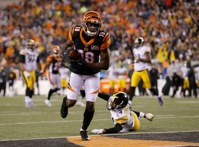 Cincinnati Bengals wide receiver A.J. Green (18) steps into the end zone for a touchdown reception in the second quarter of the NFL Week 13 game between the Cincinnati Bengals and the Pittsburgh Steelers at Paul Brown Stadium in downtown Cincinnati on Monday, Dec. 4, 2017.