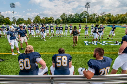 Elder High School graduates Cole Tepe (No. 60) and Brad Murphy (No. 58) are the face of the Mount St. Joseph football program this year.