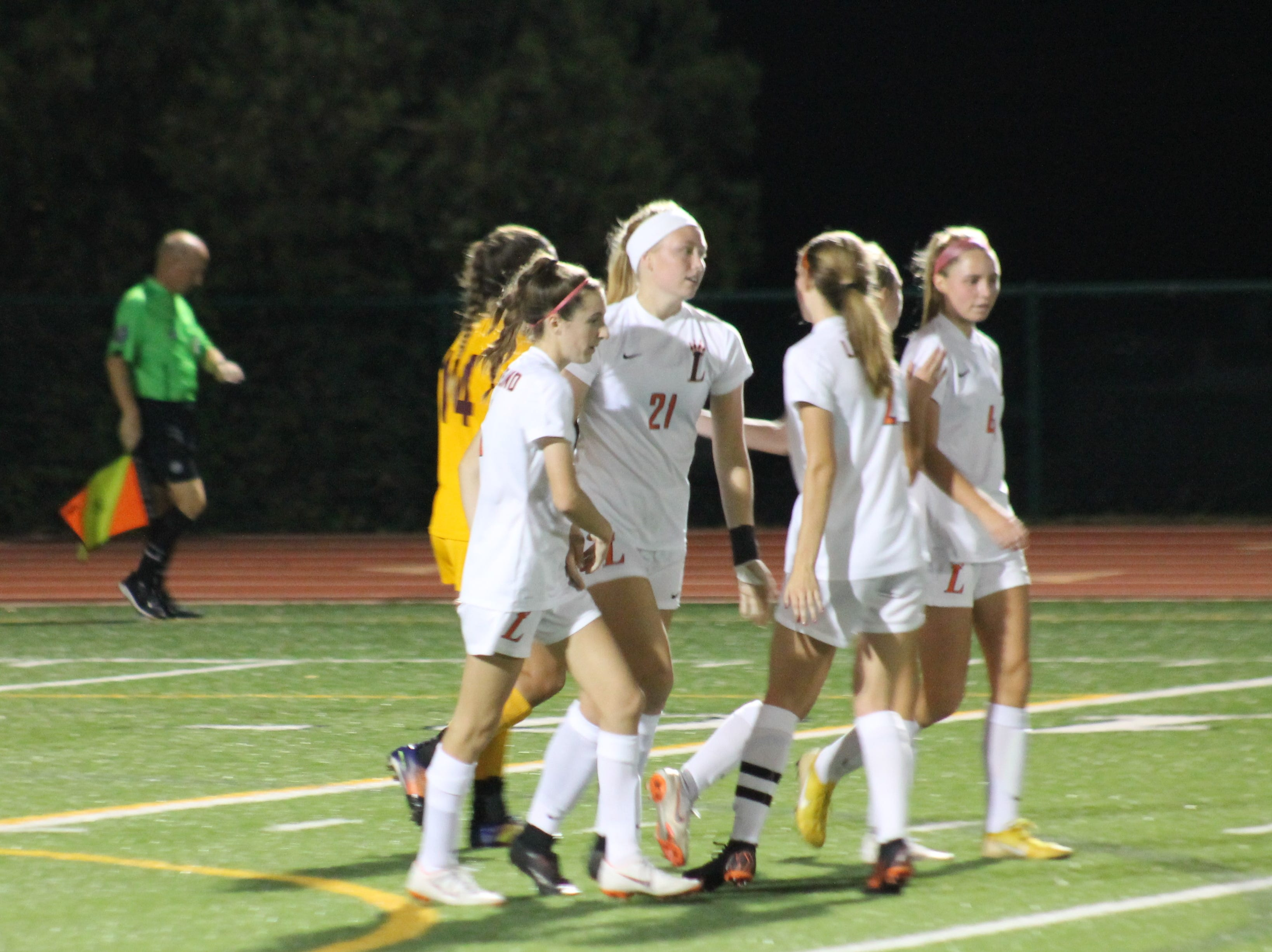 Loveland's Lauren Williams is congratulated after scoring the third and final goal for the Lady Tigers against Turpin