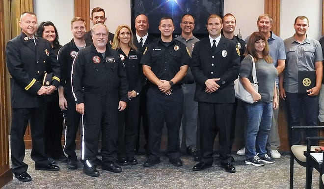 After being electrocuted at a warehouse he owns in Fairfield, Steve Tacy, second from right, was helped by a team that included first responders, Air Care and city employees. From left: Jamie Ruhl, Tracy Brown, Michael Klazsky, Brent Gerrety, Leff Logeman, Jennifer Hacker, Jon Krueckeberg, Chris Simpson, John Meyer, Kyle Schauer, Craig Moore, Jane Tacy (wife), Steve Tacy and Tyler Tacy (son).