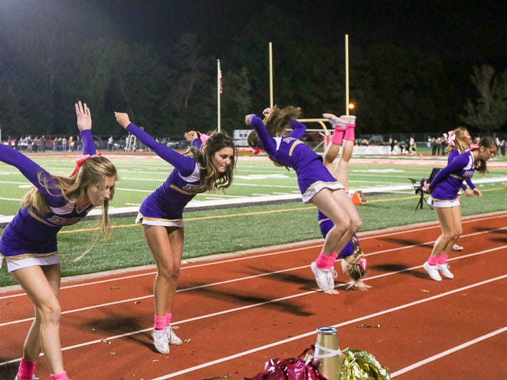 Monroe cheerleaders perform at a football game on Friday, Oct. 5, 2018 in Woodbridge.