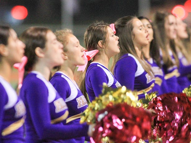 Brooke Sommer and the Monroe cheerleaders perform at a football game on Friday, Oct. 5, 2018 in Woodbridge.