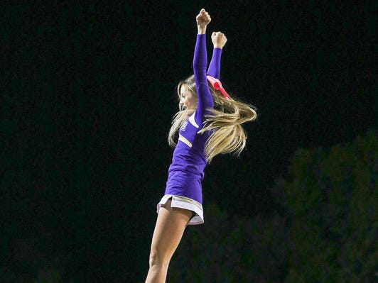 Nyla McCloskey and the Monroe cheerleaders perform at a football game on Friday, Oct. 5, 2018 in Woodbridge.
