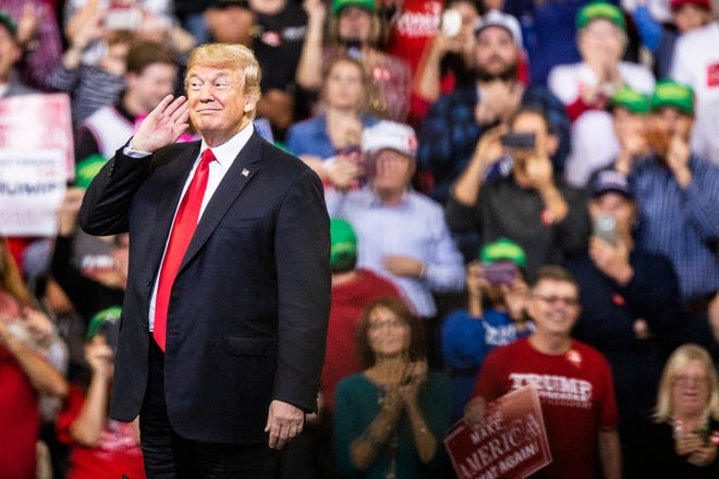 President Donald Trump enters Mid-America Center to a standing-room-only crowd during a rally on Tuesday, Oct. 9, 2018, in Council Bluffs.