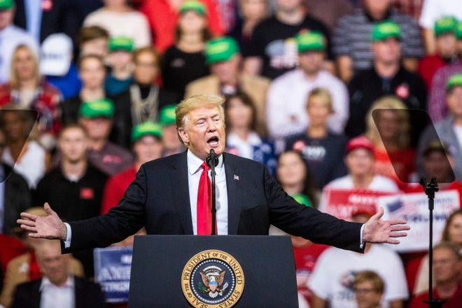 President Donald Trump speaks to a crowd of people during a rally at the Mid-America Center on Tuesday, Oct. 9, 2018, in Council Bluffs.