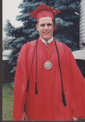 Register columnist Daniel P. Finney photographed on the day of his graduation from East High School.