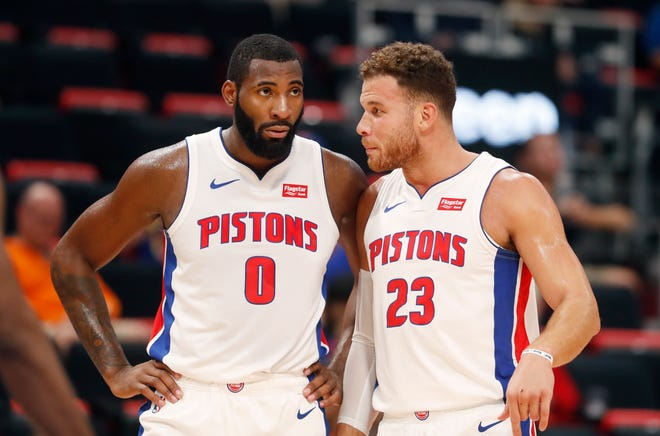 Pistons center Andre Drummond, left, and forward Blake Griffin talk during the second half of a preseason game in Detroit, Oct. 8.