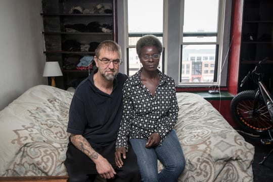 Tenant Brian Demarest and his girlfriend Harrietta Watson pose for a photo in their apartment at Park Avenue Hotel in Detroit, Tuesday, October 9, 2018.