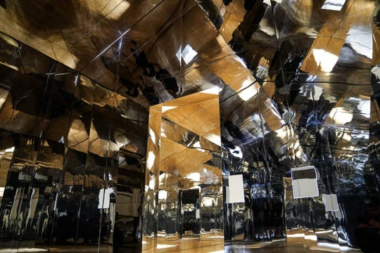 """An interior view of mirrored house created by LA artist Doug Aitken for his exhibit """"Mirage Detroit"""" is seen on display in the lobby of the State Savings Bank in downtown Detroit on Tuesday, October 9, 2018."""