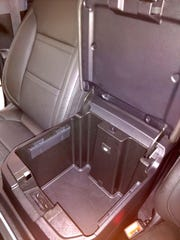 The 2019 GMC Sierra Denali's center console allows Kurt Wagner to hang his work files in it.
