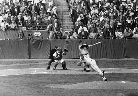 Detroit Tigers pitcher Mickey Lolich slams his first major league home run in third inning of Game 2 of the World Series against St. Louis Cardinals pitcher Nelson Briles at Busch Stadium in St. Louis, Thursday, Oct. 3, 1968. The catcher is Tim McCarver.