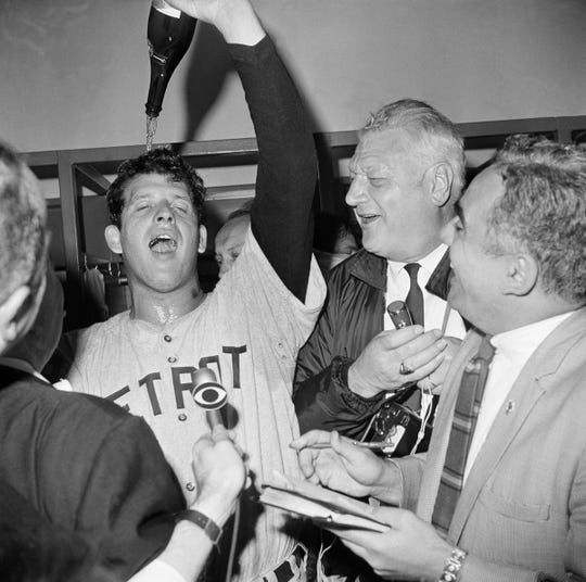 Mickey Lolich pours champagne on his head in the dressing room after Game 7 of the 1968 World Series.