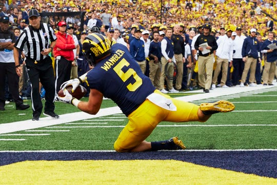 Jared Wangler catches a touchdown against Maryland.