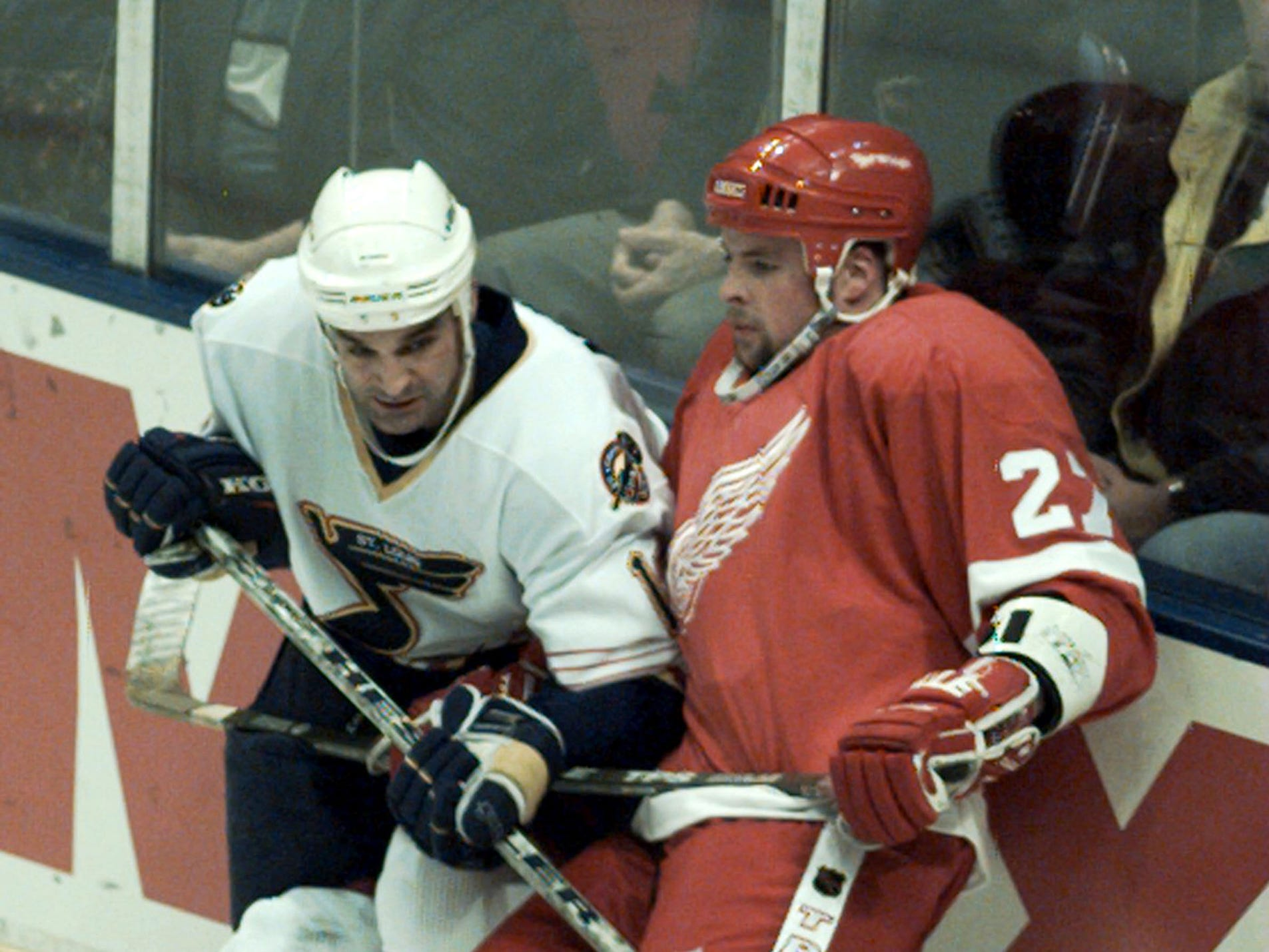 Blues Right Wing Joe Murphy(#17) ties up Aaron Ward(#27, D) in the first period.This is game 4 of the first round of playoff at the Kiel Center in St. Louis.