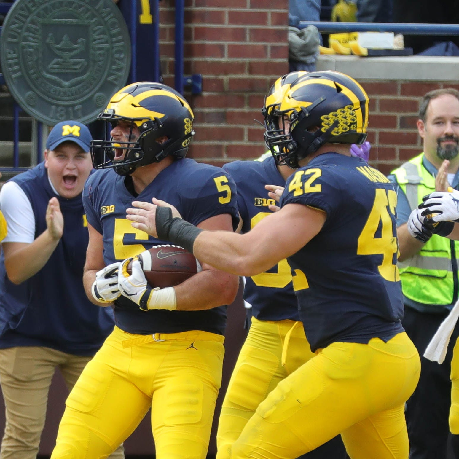 Michigan's Jared Wangler celebrates his touchdown against Maryland during the second half Saturday, Oct. 6, 2018 at Michigan Stadium.