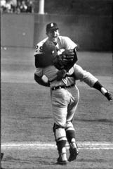 Detroit Tigers pitcher Mickey Lolich leaps into the arms catcher Bill Freehan after Freehan hauled in the final out in Game 7 of the World Series to give the Tigers the title over the St. Louis Cardinals, Thursday, Oct. 10, 1968 at at Busch Stadium in St. Louis.