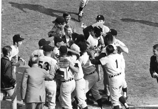 Mickey Lolich is mobbed by teammates after defeating the Cardinals, 4-1, in Game 7 of the World Series at Busch Stadium in St. Louis, Oct. 10, 1968.