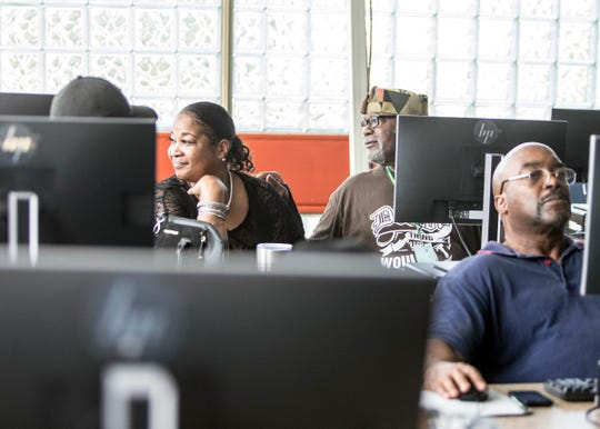 From left, Sharlene Taylor, 54 attends a seniors computer class with her father Richard Taylor, 80 and Charles Minor, 60, all of Detroit, at the Joseph Walker Williams Community Center in Detroit on Friday, Oct 5, 2018.