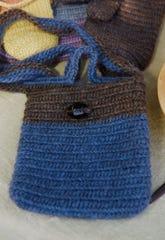 A wool hand bag by Cristina Yonce using nalbinding.