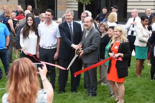 Dearborn mayor John B. O'Reilly Jr., right, holding scissors. et.