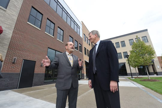 Dearborn mayor John B. O'Reilly Jr., left, at the ceremony.   Ford Land, the real estate arm of Ford Motor Co., is holding a ribbon cutting ceremony for its Wagner Place renovations. The $60 million project in downtown Dearborn included the renovations of the 120-year-old Wagner Hotel, known for its iconic turret.