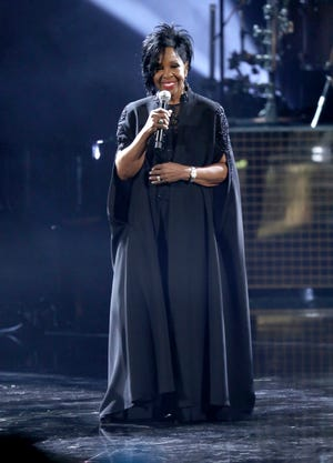 """Gladys Knight performs """"Amazing Grace"""" during a tribute to the late singer Aretha Franklin at the American Music Awards on Tuesday at the Microsoft Theater in Los Angeles."""