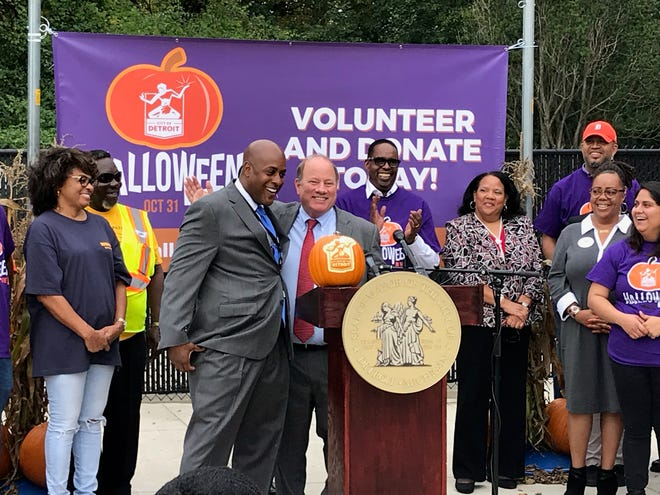 Detroit Fire Commissioner Eric Jones, left, and Mayor Mike Duggan discuss plans for the city's Halloween activities at a news conference Wednesday, Oct. 10, 2018.