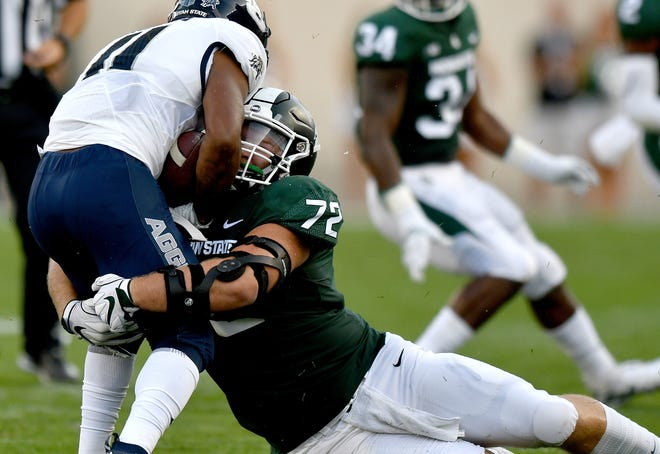 Mike Panasiuk (72) has teamed with Raequan Williams to give Michigan State a formidable duo in the middle of its run defense.