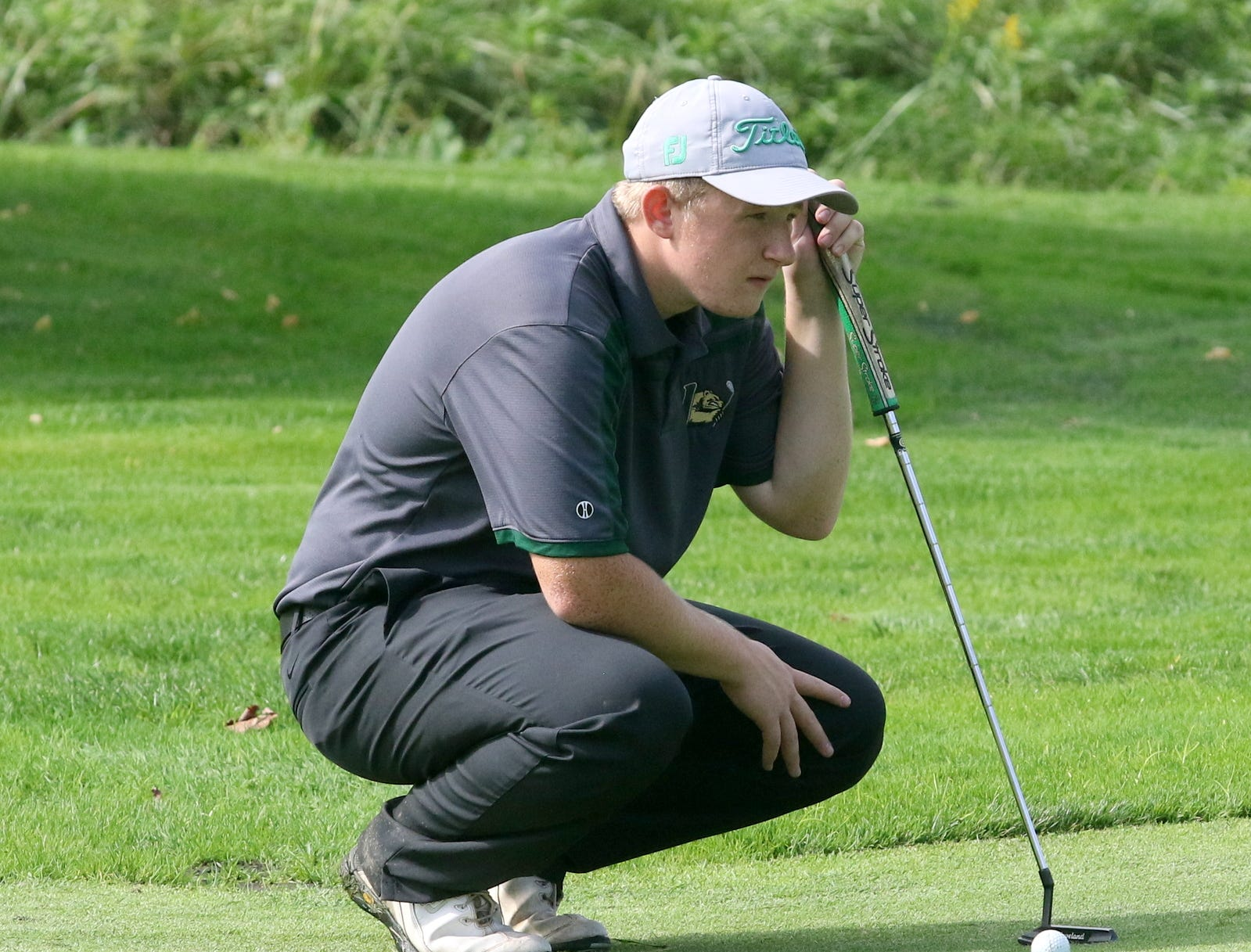 Individual runner-up Zach Keesler of Vestal lines up a putt on the 15th hole during the STAC golf championships Oct. 9, 2018 at Robert Trent Jones Golf Course in Ithaca.
